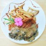 Pork Schnitzel with fries and mushroom cream sauce