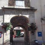 Walk through the 13th century village entrance , straight to the restaurant