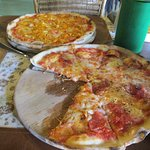 spicy salami pizza and chicken (curry) pizza
