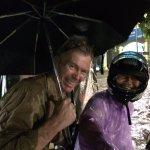 Mr Morom and Steve in a minor flood when tuk tuk stalled