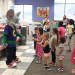 They just love Chuck E. Cheese!