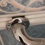 Toilet handle hanging off