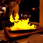 The spectacle of the salt baked fish, being set alight at the table