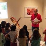 Artists explaining his work to children