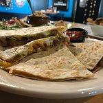 QUESADILLA  cheddar & jack cheeses, pepper & onion stuffed tortilla served with salsa & sour cre