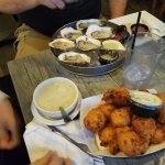 Oysters, clam chowder and clam cakes