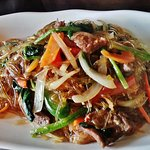 Chap Jae - Korean potato glass noodle salad fried with beef and vegetables.
