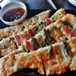 Par-Jeon - Korean seafood pancake with crabsticks, squid and spring onions.