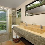 Double sinks and showers with a view at RP's 3 bedroom Whale's Tail Villa
