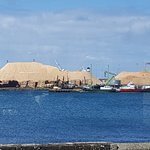 Portland harbour with wood chip piles as seen from Tram