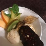 Desert of Vanilla Ice Cream and exotic fruit with chocolate crisp