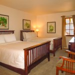 The Tracy and Hepburn room with two double beds is popular with families