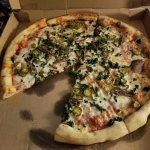 Large cheese pizza with jalapeno peppers, spinach, and.....wait for it....anchovies!