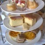 Peach pavlova, strawberry & cream, Lemon cake,shortbread, quiche, salmon sandwich