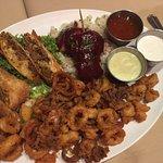 Appetizer sampler: calamari, shrimp, and meatfilled eggrolls