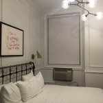 Big bed, but stark room and loud in-window A/C unit