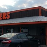 front of & entrance to Hooters