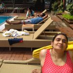 RELAXING AT POOLSIDE