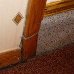 Room 411, mould and rot around skirting boards