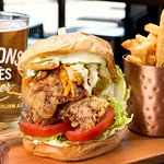Fried Chicken Sandwich and a crisp lager