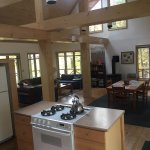 kitchen and dining and living area of chalet cabin