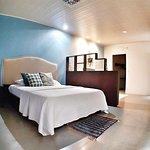 Cama habitación Yellow Tree suite