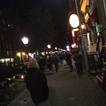 Exiting the alleyway into the Red Light district after dinner
