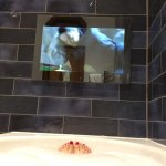 Watching television in the bath.