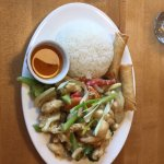 Lemon grass chicken with coconut rice and spring rolls