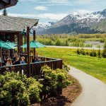 Deck overlooking the beautifully groomed grounds at Seward Windsong Lodge.