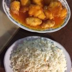 Orange chicken with rice and spring rolls