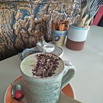 Amazing Green Tea Latte with Almond milk served in a beautiful handmade cup.