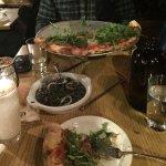 Squid ink risotto and prosciutto pizza