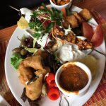 Tapas platter with a variety of items - SO GOOD!