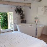 Newly decorated, our room featured pristine white linens and an in suite tub.