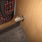Hinge not attached on the wardrobe door in one double room.