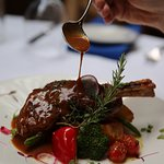 Our traditional lamb shank is slow-roasted in herbs, with olive oil imported directly from Greec