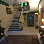 Front entry and grand staircase to upstairs.