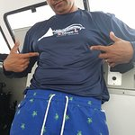 My Husband Tony rapping his Living the dream dive shirt and turtle swim trunks