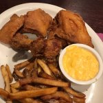 Fried chicken with French fries and cheese grits