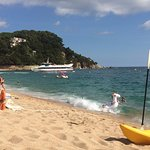Lloret beach front with boat approching