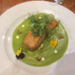 Baked Salmon Fillet with Pea and Asparagus Sauce. Note the edible flowers.