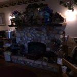 area in breakfast nook. lovely fireplace