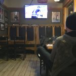 Comfortably-seated patron watching the hockey game.