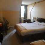 deluxe room with double bed and small window