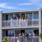 Wedding party on balcony facing pool