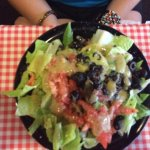 Small dinner salad. Comes with tomato and black olives. I use the garlic vinaigrette dressing.