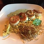 Scallops over polenta with shoestring, fried onions.