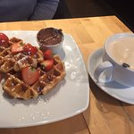 Latte and waffles with nutella