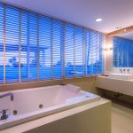 Beachfront Jacuzzi Suite No. 105 is Mediterranean style with double bed, living room & balcony.